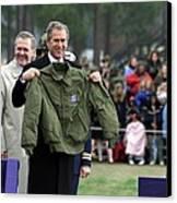 President Bush Displays A Jacket Given Canvas Print by Everett
