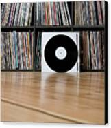 Records Leaning Against Shelves Canvas Print by Halfdark