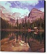 Reflection Of Cabins And Mountains In Canvas Print by Carson Ganci
