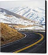 Road Through A Snowy Mountain Landscape Canvas Print by Thom Gourley/Flatbread Images, LLC