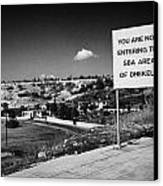 sign overlooking pyla and turkish controlled territory marking entrance of SBA Sovereign Base area Canvas Print by Joe Fox