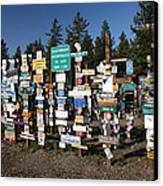 Sign Posts Forest In Watson Lake Yukon Canvas Print by Mark Duffy