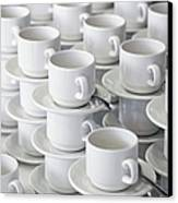 Stacks Of Cups And Saucers Canvas Print by Tobias Titz