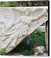 Stone Carving Of Nike Canvas Print by Mark Greenberg
