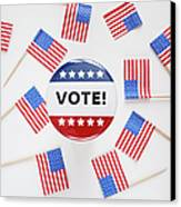 Studio Shot Of Vote Pin And Small American Flags Canvas Print by Winslow Productions