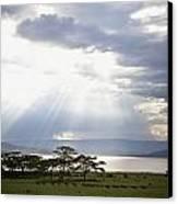 Sunlight Shines Down Through The Clouds Canvas Print by David DuChemin