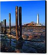 Sunset At St. Mary's Lighthouse Canvas Print by Michael Oakes