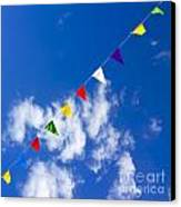 Suspended Festive Flags. Canvas Print by Bernard Jaubert