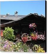 Swiss Chalet Interlaken Canvas Print by Marilyn Dunlap