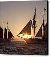 Tall Ships At Sunset Canvas Print by Cliff Wassmann