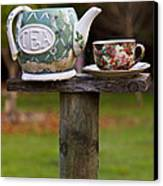 Teapot And Tea Cup On Old Post Canvas Print by Garry Gay