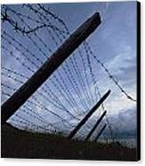 The Remains Of A Barbed Wire Fence That Canvas Print by Steve Raymer