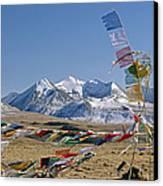 Tibetan Buddhist Prayer Flags Atop Pass Canvas Print by Gordon Wiltsie