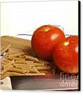 Tomatoes Pasta And Knife Canvas Print by Blink Images