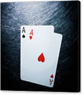 Two Aces Playing Cards On Stainless Steel. Canvas Print by Ballyscanlon