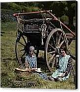Two Girls Eat Lunch In A Hayfield Canvas Print by Clifton R. Adams