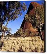 Uluru, Ayres Rock Against A Clear Blue Canvas Print by Jason Edwards