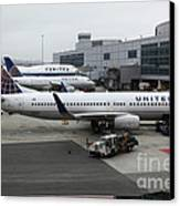 United Airlines At Foggy Sfo International Airport . 5d16937 Canvas Print by Wingsdomain Art and Photography