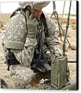 U.s. Army Soldier Performs A Radio Canvas Print by Stocktrek Images