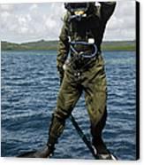 U.s. Navy Diver Jumps Off A Dive Canvas Print by Stocktrek Images