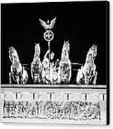 viktoria with quadriga on top of the Brandenburg gate at night Berlin Germany Canvas Print by Joe Fox