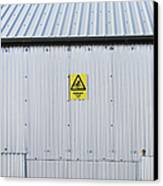 Warning Sign On An Industrial Building Canvas Print by Iain Sarjeant