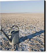 Water Pail On Dried Mud Canvas Print by Thom Gourley/Flatbread Images, LLC