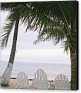 White Beach Chairs Line The Shore Canvas Print by Stephen Alvarez