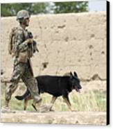 A Dog Handler Of The U.s. Marine Corps Canvas Print by Stocktrek Images