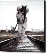 A Military Dog Handler Uses An Canvas Print by Stocktrek Images