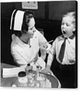 A Nurse Examining The Teeth Of A Boy Canvas Print by Everett