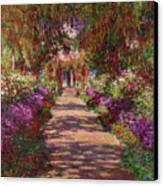 A Pathway In Monets Garden Giverny Canvas Print by Claude Monet