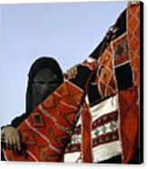 A Veiled Bedouin Woman Peers Canvas Print by Thomas J. Abercrombie
