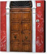 an old wooden door in Italy Canvas Print by Joana Kruse