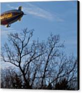 Blimp Over Wingfoot Canvas Print by Tim Fitzwater