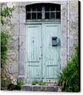Blue Door In Vianne France Canvas Print by Marion McCristall