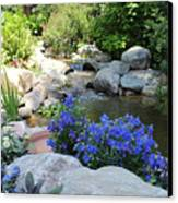 Blue Flowers And Stream Canvas Print by Corey Ford