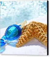 Blue Goggles On A White Towel  Canvas Print by Sandra Cunningham