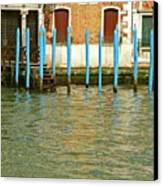 Blue Poles In Venice Canvas Print by Michael Henderson
