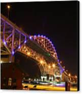 Blue Water Bridge At Night Canvas Print by Paul Bartoszek