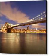 Brooklyn Bridge And Manhattan At Night Canvas Print by J. Andruckow