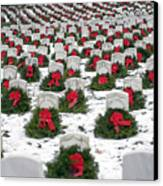Christmas Wreaths Adorn Headstones Canvas Print by Stocktrek Images