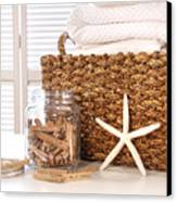 Closeup Of Laundry Basket With Fine Linens  Canvas Print by Sandra Cunningham