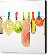 Components Of Sandwich Pegged To Washing Line Canvas Print by Image by Catherine MacBride