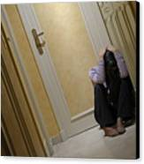 Depressed Woman Sitting In Corridor With Head In Hands Canvas Print by Sami Sarkis