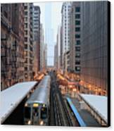 Elevated Commuter Train In Chicago Loop Canvas Print by Photo by John Crouch