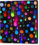 Falling Balls Of Color Canvas Print by Carl Deaville