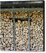 Firewood Stack Canvas Print by Frank Tschakert