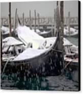 Gondolas In Venice In The Snow Canvas Print by Michael Henderson