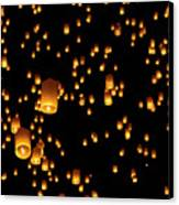 Hot Air Lanterns In Sky Canvas Print by Daniel Osterkamp